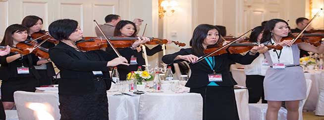 crescendo team building musical activity people pay violins