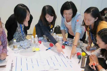 team collaborate in innovative team building game speak up speak out