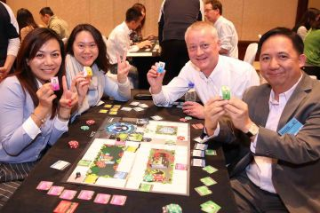 people playing freshbiz experiential business game