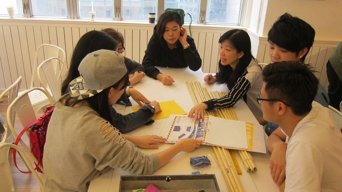 group of employees engaging in teambuilding activity