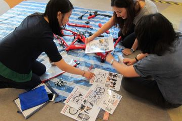 women collaborate to complete building a dream team building activity
