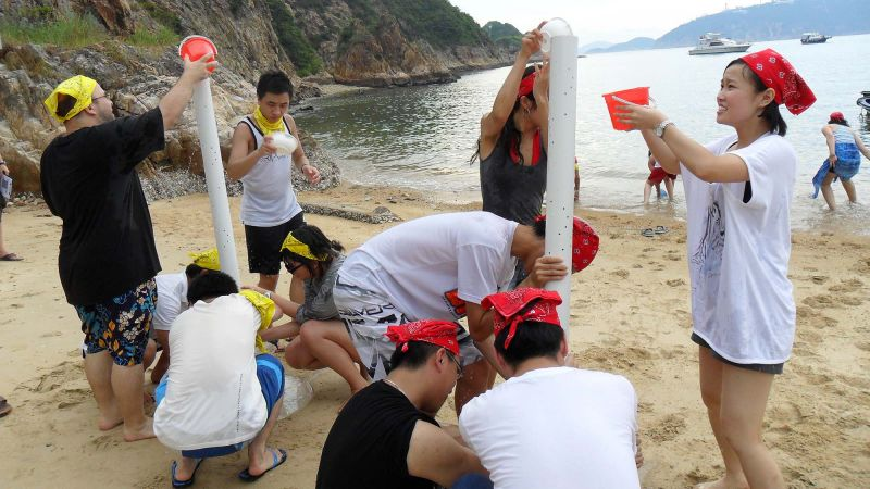 people bonding on the beach relaxing outdoor team building activity