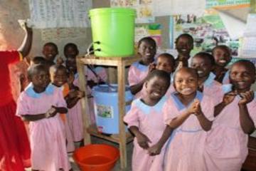 Children receiving finished waterworks