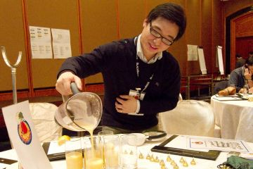 man pours juice into cups creative juices team buildingactivity