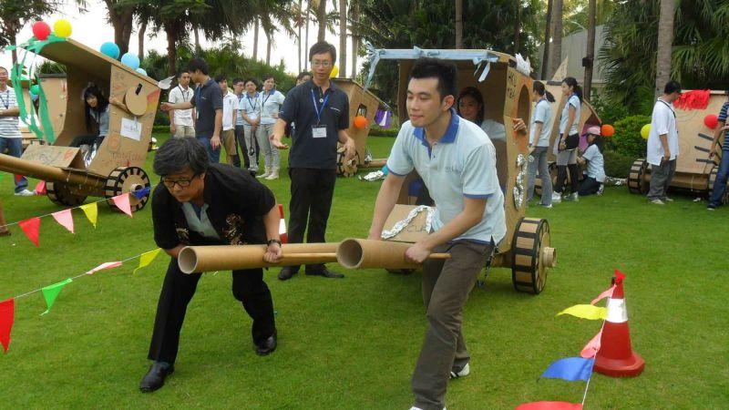 people racing the cardboard rickshaws fun team building activity