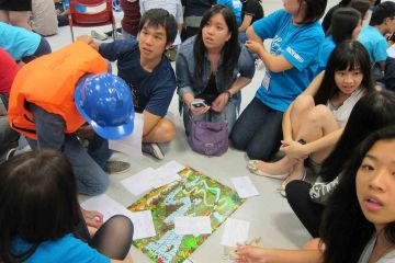 team collaborate to complete rags to riches charity team building event
