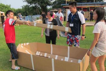 team collaborate to build a cardboard racing boat flat out afloat team building challenge rabobank