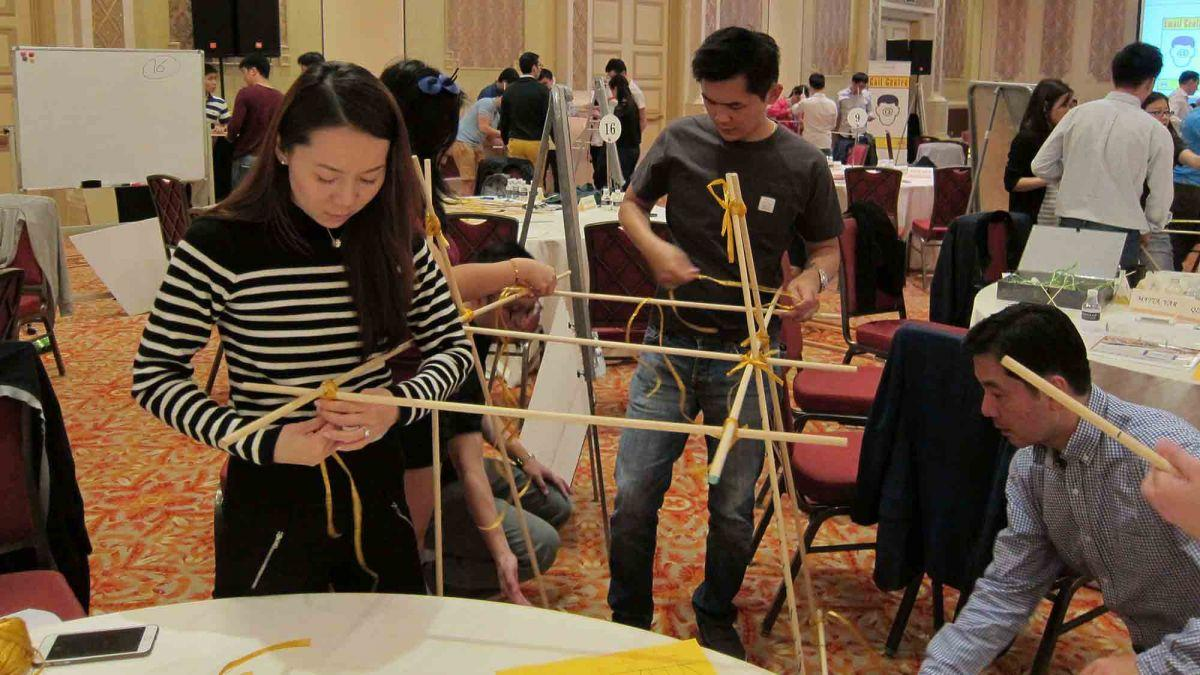 team collaborate to build a giant bridge giant