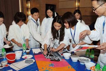 team collaborate to paint a big picture creative team building activity bp