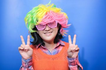 woman with funny wig unny wig and a big bow tie in the picture fun team building activity