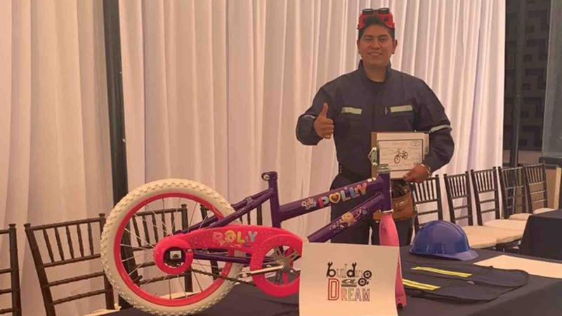 Genworth give bicycles to children
