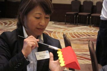 employee builds a toy for children in toy factory team building activity