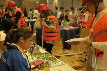 People in life vests at trading table