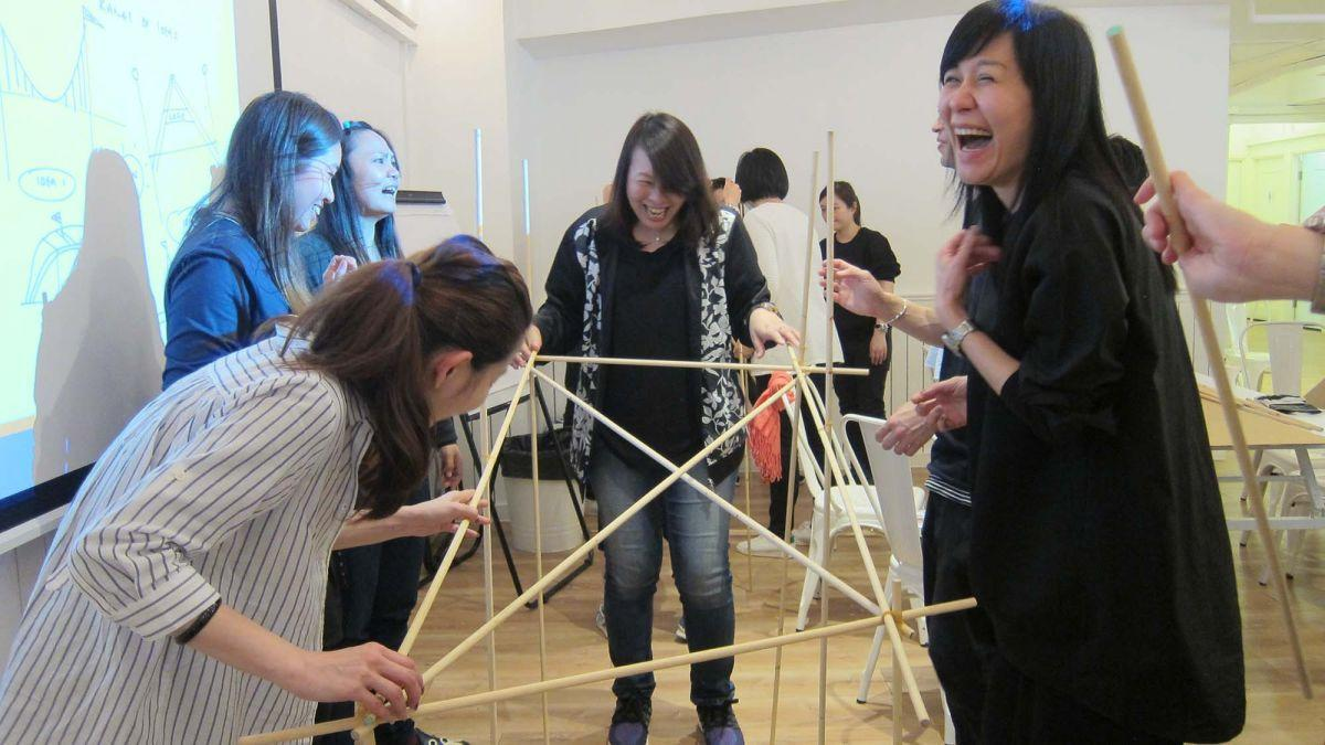employees collaborating team building activity resized