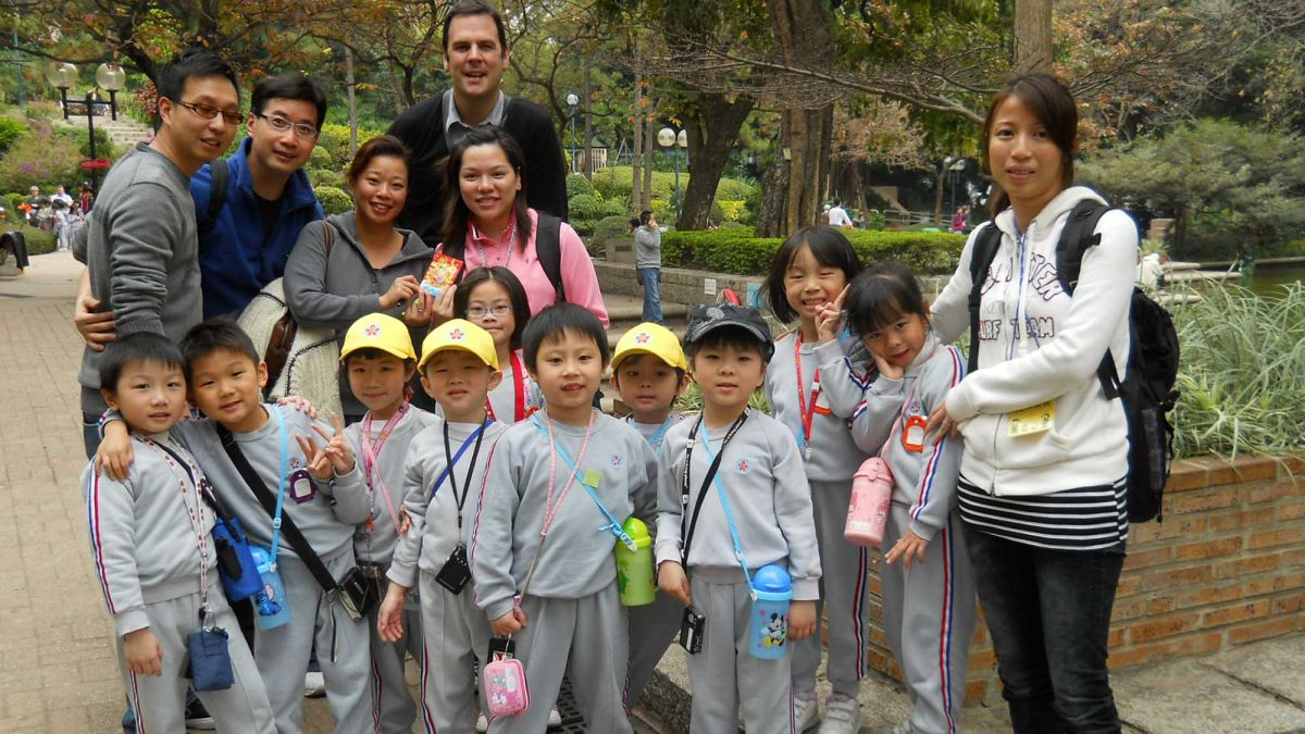 employees with group of children CSR activity