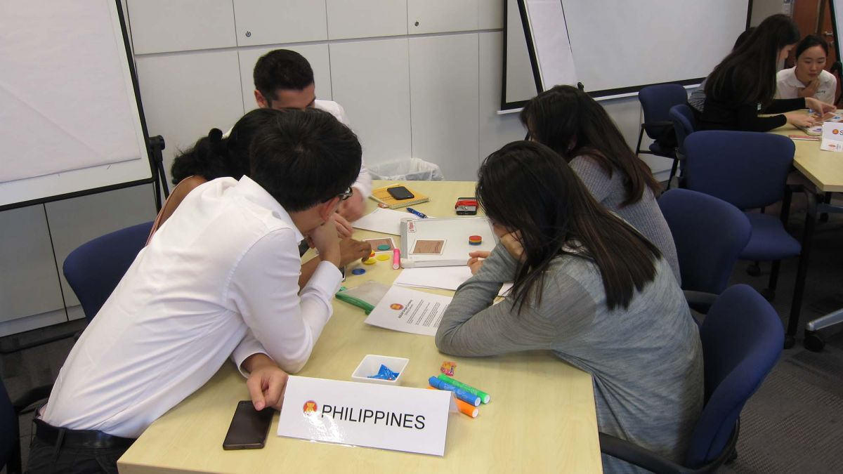 employees discuss points during coaching session