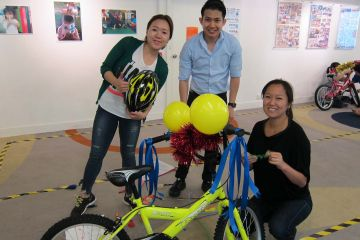 employees collaborate to build bikes in building a dream team building  activity