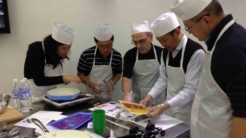 sausage sensation cooking team building activity