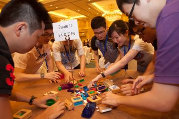 team collaborates to complete fun team building activity need 4 speed