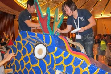 two people paint the dragon in team building activity dragon squad