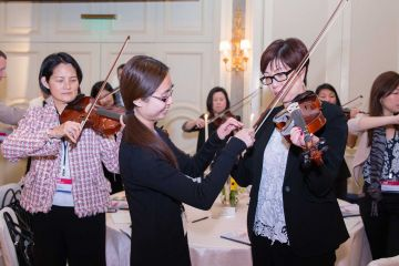 people playing instruments crescendo musical team building activity