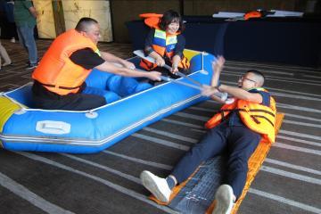 people in raft saving someone