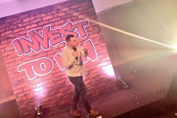 Beatboxing on stage at a team building event