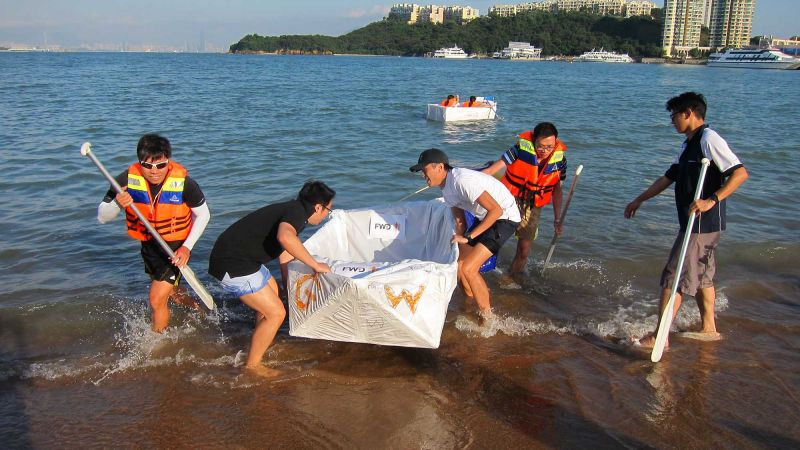 team collaborate to put race boat in the water