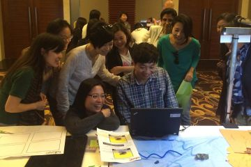 employees collaborate to complete animate team building activity
