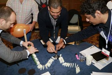 the domino effect creative team building activity