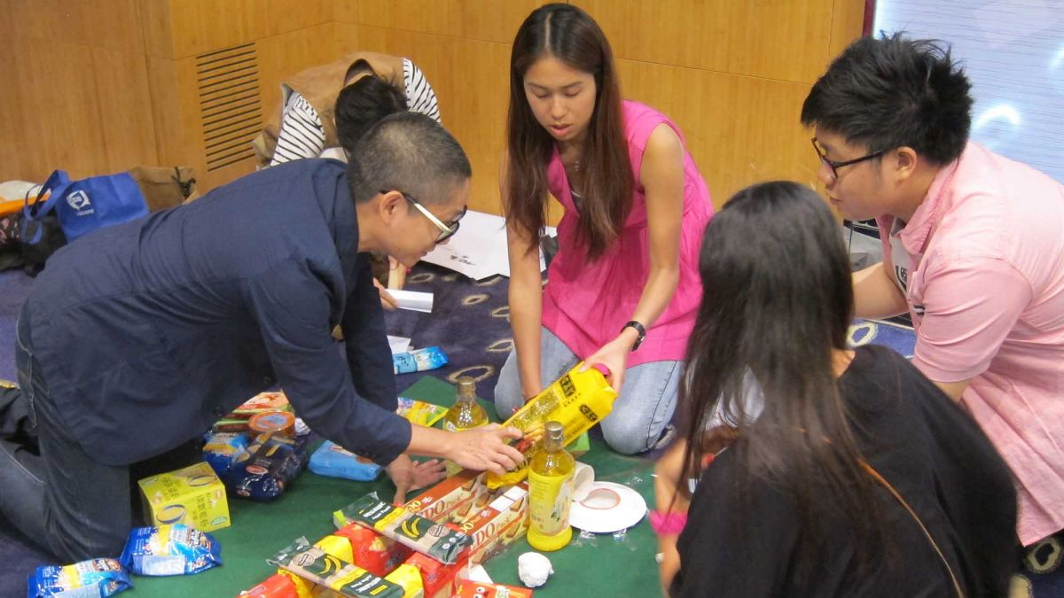team collaborate to complete challenging team building game