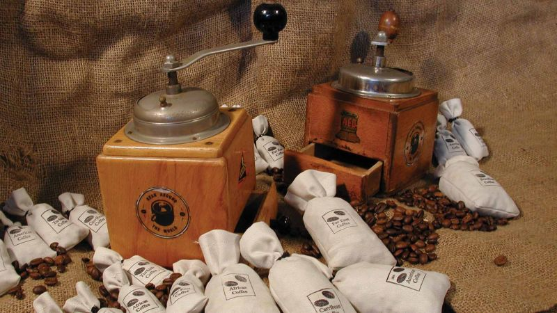 Coffee grinder and coffee bags laid out on a hessian bag ready for Catalyst team building activity Bean Around the World