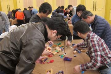 team collaborate to complete team building challenge beijing