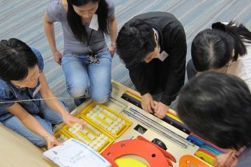 employees collaborate in strategic team building activity