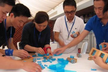 team collaborate to complete need for speed team building business game