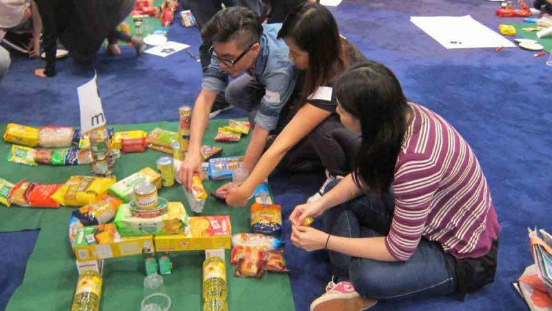 three people managing the resources they have in Catalyst team building activity Hole in One